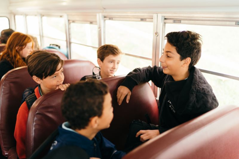 Students talking on bus