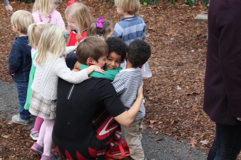 Lower school students hugging