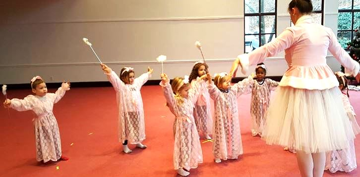 nursery students dance lesson dressed as angels