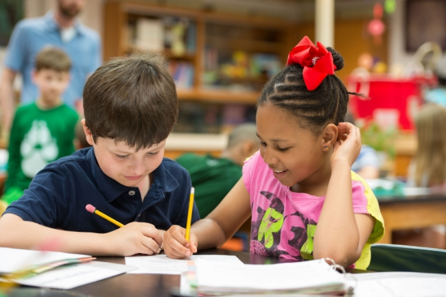 Lower school students writing together