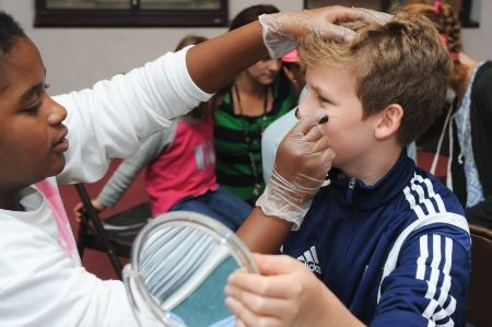Boy having his face painted