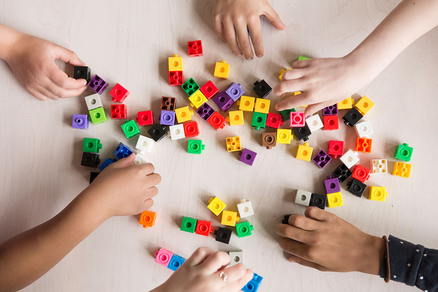 Student hands with snap together blocks