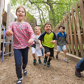 group of lower school students running